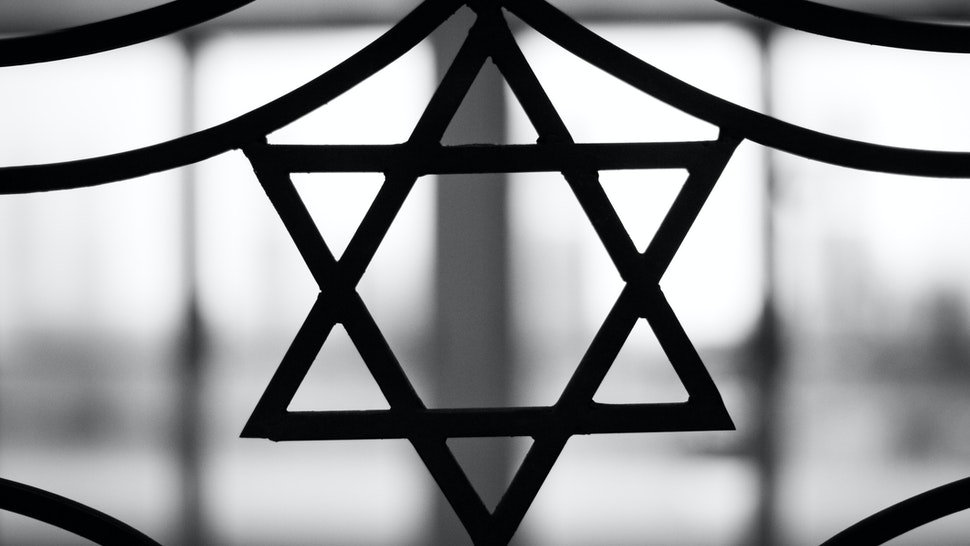 Iron casted Star in black and White with a dramatic back light overtone. The Star of David, known in Hebrew as the Shield of David or Magen David, is the quintessential symbol of Jewish identity.