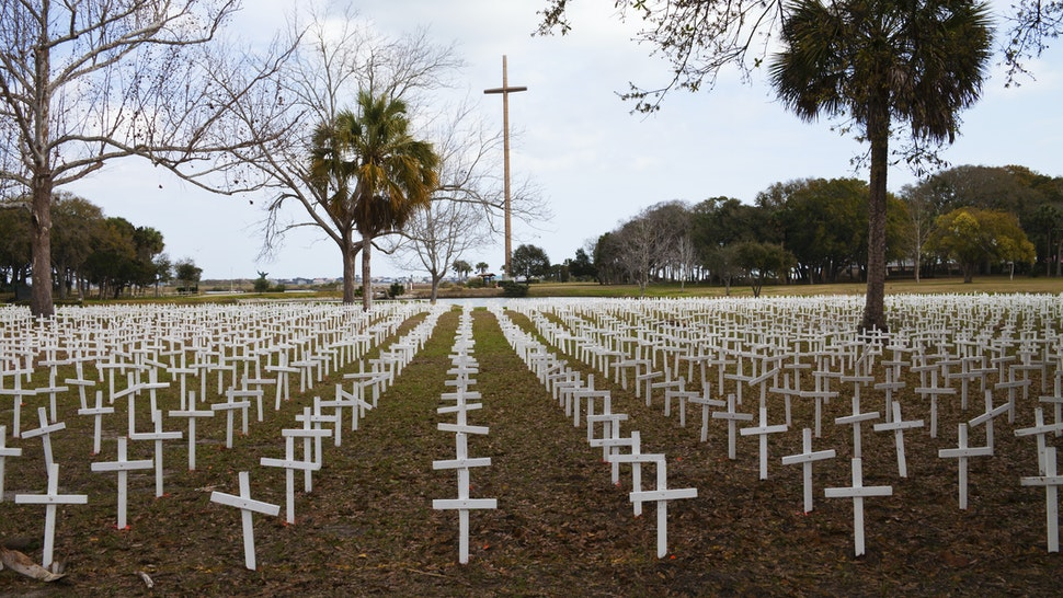 Thousands of white crosses at the Cemetery of the Innocent, in St Augustine, Florida represent the 4000 babies who are aborted daily in the United States. In the background stands the Great Cross, marking where Christianity first came to America.