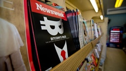 A copy of the new print edition of Newsweek magazine is diplayed in a newsstand in Washington on March 10, 2014. Newsweek, online only since the end of 2012, returned to print on March 7 in the United States and Europe. Parent company IBT Media is taking a gamble in re-launching the once-iconic news weekly, which has nearly disappeared in the face of serious financial difficulties. In crafting its print resurrection, the New York-based online media group, led by French businessman Etienne Uzac, has adopted a strategy that goes against current practices. The new magazine will seek to position itself as a high-end product, in particular with higher quality paper and printing than its competitors. AFP PHOTO/Nicholas KAMM (Photo credit should read NICHOLAS KAMM/AFP via Getty Images)
