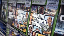 "Copies of Take-Two Interactive Software Inc. ""Grand Theft Auto V"" for the Microsoft Corp. Xbox 360 game system sit on display for sale at a GameStop Corp. store in Peru, Illinois, U.S., on Wednesday, March 26, 2014."