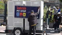 John Leggett helps to install portable toilets in the Tenderloin district of San Francisco, California on Tuesday, June, 28, 2016. The Tenderloin district is commonly known as a hotbed for homelessness where people often relieve themselves on the streets. (Photo by Josh Edelson / AFP) (Photo credit should read JOSH EDELSON/AFP via Getty Images)