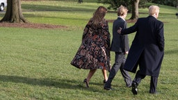 President Donald Trump leaves the White House with First Lady Melania Trump and son Barron Trump, as they depart for the Thanksgiving Holiday from the South Lawn of the White House in Washington, DC, on November 21, 2017.