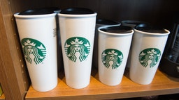 Starbucks coffee mugs are for sale inside a Starbucks Coffee shop in Washington, DC, April 17, 2018.