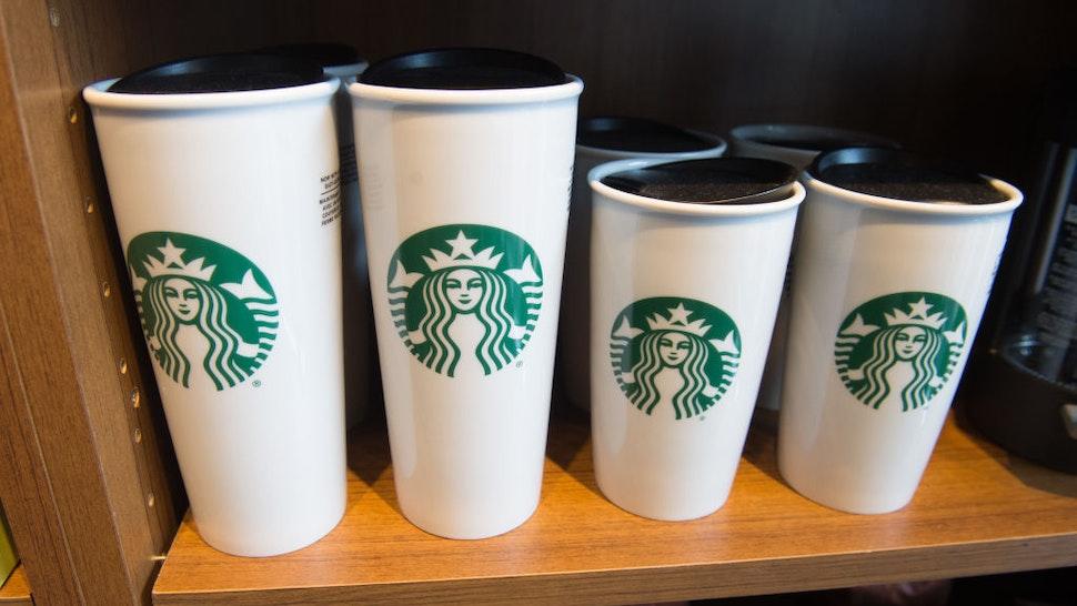 Starbucks coffee mugs are for sale inside a Starbucks Coffee shop in Washington, DC, April 17, 2018.