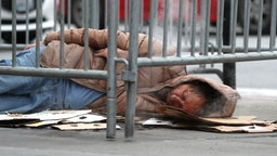 DECEMBER 05: A homeless man sleeps on the sidewalk on December 05, 2019 in San Francisco, California. California Gov. Gavin Newsom announced plans to release $650 million in emergency aid that will allocated to California cities and counties in an effort to combat the state's homelessness crisis.