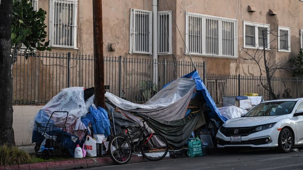 Tents sheltering homeless people line a residential street in Los Angeles, California, December 9, 2019. - At the behest of Los Angeles and local governments across the west, the US Supreme Court is considering a ruling by the 9th Circuit Court of Appeals that requires cities to allow people to sleep in public places including sidewalks as long as there are not enough public shelter beds for every person in need. Over half a million people in the US are homeless on a single night, according to a report released in September by the White House's The Council of Economic Advisers.