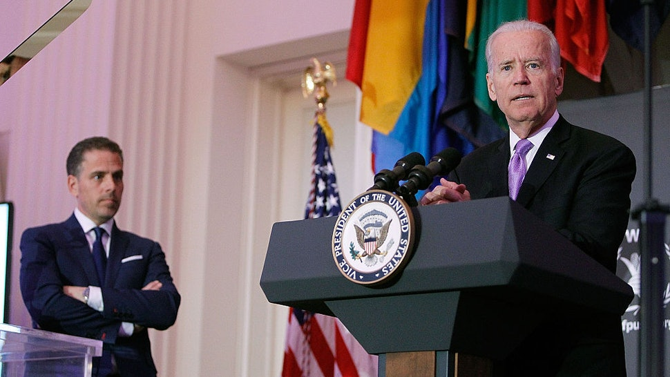 Vice President Joe Biden (R) speaks as his son, Hunter Biden, looks on at the World Food Program USA's Annual McGovern-Dole Leadership Award Ceremony at Organization of American States on April 12, 2016 in Washington, DC. (Photo by Paul Morigi/Getty Images for World Food Program USA)
