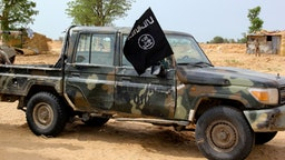 A vehicle allegedly belonging to the Islamic State group in West Africa (ISWAP) is seen in Baga on August 2, 2019. - Intense fighting between a regional force and the Islamic State group in West Africa (ISWAP) has resulted in dozens of deaths, including at least 25 soldiers and more than 40 jihadists, in northeastern Nigeria. ISWAP broke away from Boko Haram in 2016 in part due to its rejection of indiscriminate attacks on civilians. Last year the group witnessed a reported takeover by more hardline fighters who sidelined its leader and executed his deputy. The IS-affiliate has since July 2018 ratcheted up a campaign of attacks against military targets.