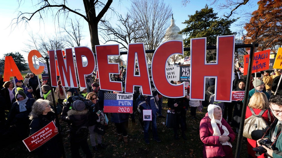 Protesters supporting the impeachment of U.S. President Donald Trump gather outside the U.S. Capitol December 18, 2019 in Washington, DC. Later today the U.S. House of Representatives is expected to vote on two articles of impeachment against Trump charging him with abuse of power and obstruction of Congress. (Photo by Win McNamee/Getty Images)