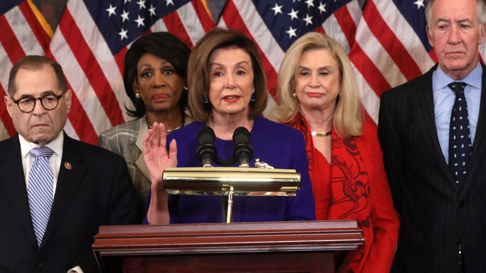 WASHINGTON, DC - DECEMBER 10: Speaker of the House Rep. Nancy Pelosi (D-CA) (C) speaks as (L-R) Chairman of House Judiciary Committee Rep. Jerry Nadler (D-NY), Chairwoman of House Financial Services Committee Rep. Maxine Waters (D-CA), Chairwoman of House Oversight and Reform Committee Rep. Carolyn Maloney (D-NY) and Chairman of House Ways and Means Committee Rep. Richard Neal (D-MA) listen during a news conference at the U.S. Capitol December 10, 2019 in Washington, DC. Chairman Nadler announced that the Judiciary Committee is introducing two articles on abuse of power and obstruction of Congress for the next steps in the House impeachment inquiry against President Donald Trump.