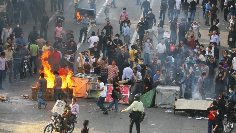 TEHRAN, IRAN - JUNE 20: Supporters of Iran's defeated presidential candidate Mir Hossein Mousavi set burning barricades in the streets as they protest during a demonstration on June 20, 2009 in Tehran, Iran. Thousands of Iranians clashed with police as they defied an ultimatum from supreme leader Ayatollah Ali Khamenei calling for an end to protests over last week's disputed presidential election results. Iranian police have tried to break up protest using water cannon, tear gas, batons and live rounds.