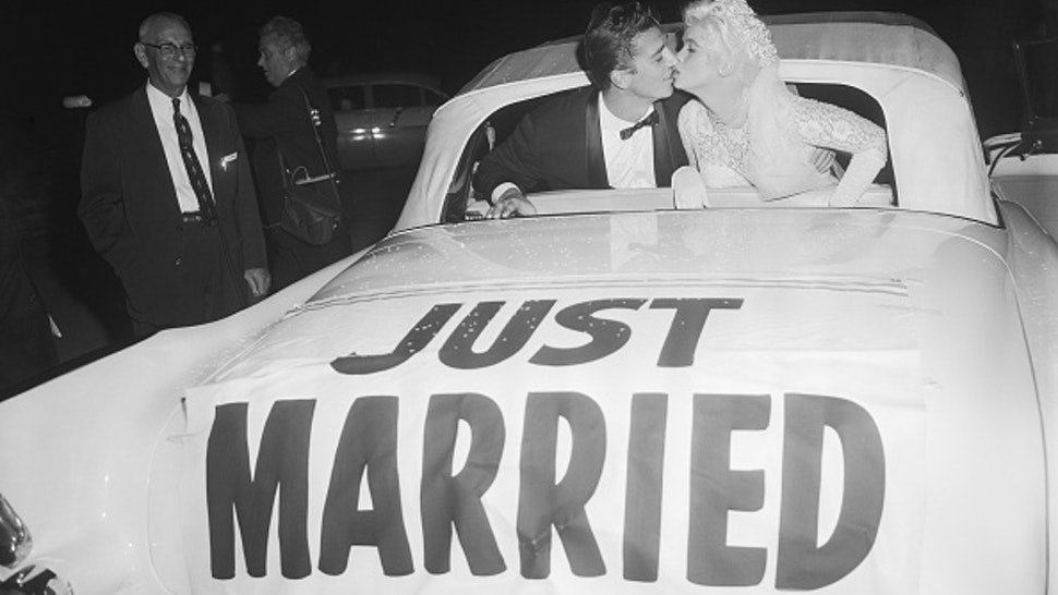 (Original Caption) 1/15/1958-Palos Verdes, CA- Actress Jayne Mansfield receives a kiss from her bridegroom Mickey Hargitay following their wedding ceremony at the Glass Wayfarer's Seaside Chapel. 100 close friends attended the sedate cermony.