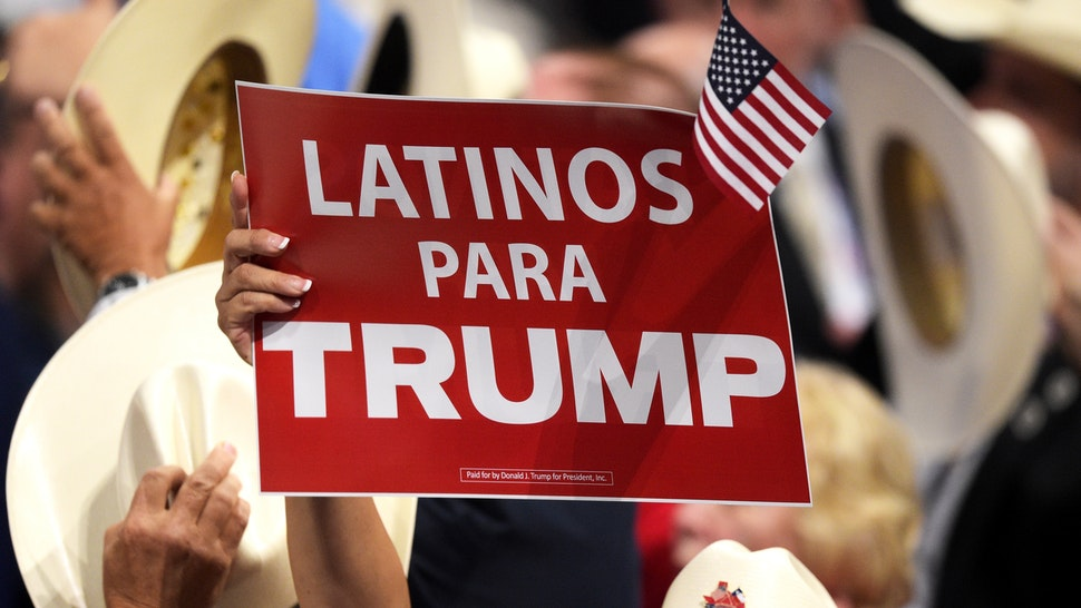 """CLEVELAND, OH - JULY 21: A delegate holds up sign that reads """"Latinos Para Trump"""" during the evening session on the fourth day of the Republican National Convention on July 21, 2016 at the Quicken Loans Arena in Cleveland, Ohio. Republican presidential candidate Donald Trump received the number of votes needed to secure the party's nomination. An estimated 50,000 people are expected in Cleveland, including hundreds of protesters and members of the media. The four-day Republican National Convention kicked off on July 18."""