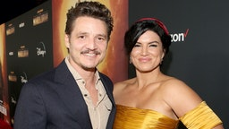 """Pedro Pascal and Gina Carano arrive at the premiere of Lucasfilm's first-ever, live-action series, """"The Mandalorian,"""" at the El Capitan Theatre in Hollywood, Calif. on November 13, 2019. """"The Mandalorian"""" streams exclusively on Disney+. (Photo by Jesse Grant/Getty Images for Disney)"""