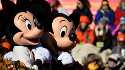 Disney's Mini and Mickey Mouse ride on a Walt Disney World carriage during the 99th 6ABC/Dunkin' Donuts Annual Thanksgiving Day parade, in Philadelphia, PA, on November 22, 2018. The annual parade on Benjamin Franklin Parkway is the oldest in the nation. (Photo by Bastiaan Slabbers/NurPhoto via Getty Images)