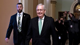 Senate Majority Leader Mitch McConnell, a Republican from Kentucky, exits following a news conference after a weekly caucus meeting at the U.S. Capitol in Washington, D.C., U.S., on Tuesday, Dec. 17, 2019. McConnell is setting a course to quash Democrat's attempts to extend the impeachment trial of President Donald Trump by calling new witnesses, with the goal of ending it swiftly in acquittal.