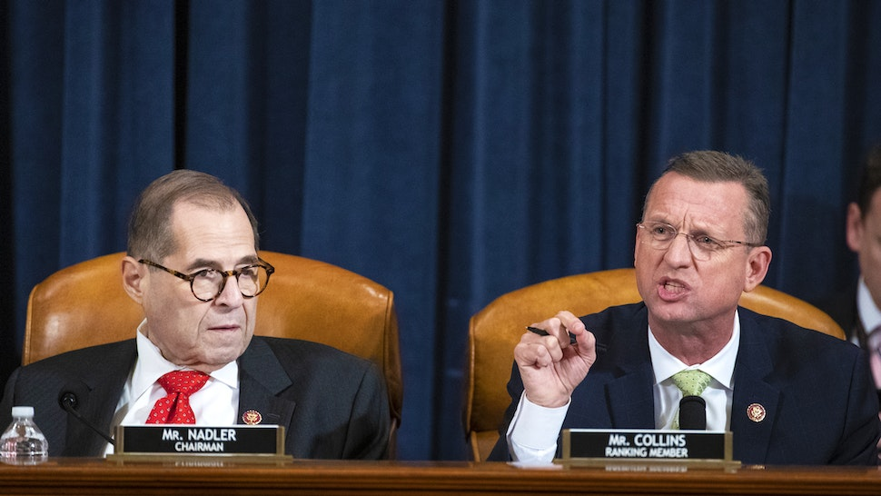 Representative Doug Collins, a Republican from Georgia and ranking member of the House Judiciary Committee, right, speaks while chairman Representative Jerry Nadler, a Democrat from New York, listens during a House Judiciary Committee hearing in Washington, D.C., U.S., on Thursday, Dec. 12, 2019. The Judiciary Committee is set to finish debating articles of impeachment against President Donald Trump today with a likely party-line vote to send the resolution to the floor of the House.