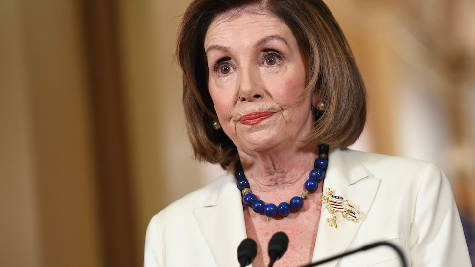 """US Speaker of the House Nancy Pelosi speaks about the impeachment inquiry of US President Donald Trump at the US Capitol in Washington, DC, on December 5, 2019. - Pelosi told congressional leaders to draw up articles of impeachment against Trump, saying his abuse of power for political benefit """"leaves us no choice but to act."""" Trump """"has engaged in abuse of power, undermined our national security and jeopardized the integrity of our elections,"""" she said, adding that """"the president leaves us no choice but to act."""""""