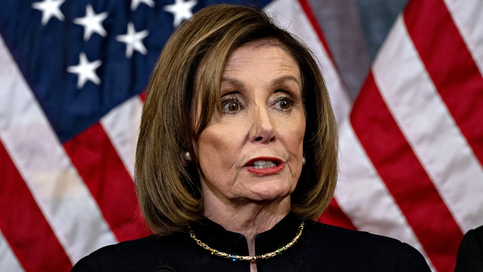 U.S. House Speaker Nancy Pelosi, a Democrat from California, speaks during a news conference after the House voted on articles of impeachment against President Donald Trump at the U.S. Capitol in Washington, D.C., U.S., on Wednesday, Dec. 18, 2019. The U.S. House of Representatives impeached Trump on charges of abuse of power and obstructing Congress, the culmination of an effort by Democrats that further inflamed partisan tensions in Washington and deepened the nations ideological divide.