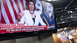 """U.S. House Speaker Nancy Pelosi, a Democrat from California, is seen speaking on a television during a news conference on Capitol Hill in Washington, D.C., U.S., on Thursday, Dec. 5, 2019. Pelosi said today that President Donald Trump's actions are a """"profound violation of the public trust"""" and she is asking Representative Jerry Nadler to proceed with drafting articles of impeachment. Photographer: Andrew Harrer/Bloomberg"""