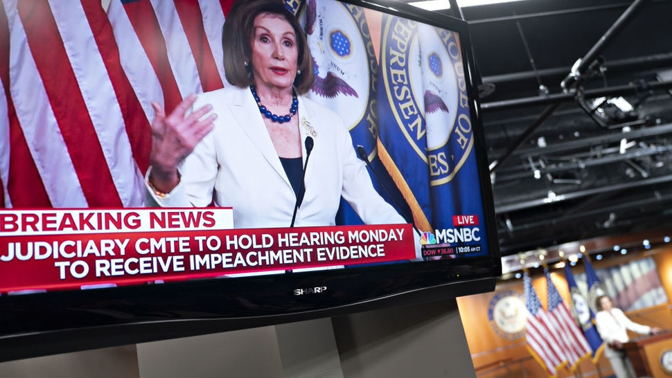 "U.S. House Speaker Nancy Pelosi, a Democrat from California, is seen speaking on a television during a news conference on Capitol Hill in Washington, D.C., U.S., on Thursday, Dec. 5, 2019. Pelosi said today that President Donald Trump's actions are a ""profound violation of the public trust"" and she is asking Representative Jerry Nadler to proceed with drafting articles of impeachment. Photographer: Andrew Harrer/Bloomberg"
