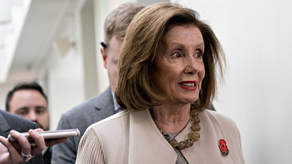 U.S. House Speaker Nancy Pelosi, a Democrat from California, exits after a House Democratic caucus meeting at the U.S. Capitol in Washington, D.C., U.S., on Tuesday, Dec. 17, 2019. The House Rules Committee this morning will begin what could be an all-day meeting to write the procedures for the floor debate and vote on impeachment of President Donald Trump. Photographer: Andrew Harrer/Bloomberg