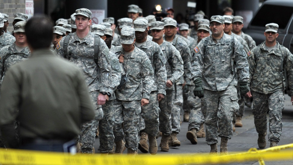 National Guard soldiers walk to Bellevue Hospital during a planned evacuation of the hospital October 31, 2012 in New York. Bellevue Hospital, the oldest in the country, decided to evacuate its remaining 500 patients on Wednesday after flooding inundated the basement and knocked out electricity.