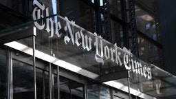The corporate logo of the New York Times hangs above the front door of their headquarters on October 23, 2018 in New York City. (Photo by Gary Hershorn/Getty Images)