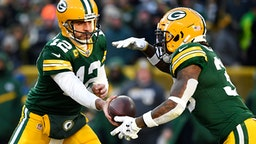GREEN BAY, WISCONSIN - DECEMBER 15: Aaron Rodgers #12 of the Green Bay Packers hands the football off during the game against the Chicago Bears at Lambeau Field on December 15, 2019 in Green Bay, Wisconsin.
