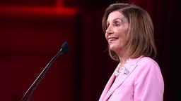 Speaker of the US House of Representatives Nancy Pelosi speaks on-stage during the Democratic National Committee's summer meeting in San Francisco, California on August 23, 2019.