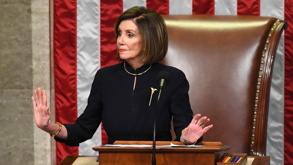 US Speaker of the House Nancy Pelosi presides over Resolution 755, Articles of Impeachment Against President Donald J. Trump as the House votes at the US Capitol in Washington, DC, on December 18, 2019. - The US House of Representatives voted 229-198 on Wednesday to impeach President Donald Trump for obstruction of Congress. The House impeached Trump for abuse of power by a 230-197 vote. The 45th US president is just the third occupant of the White House in US history to be impeached.