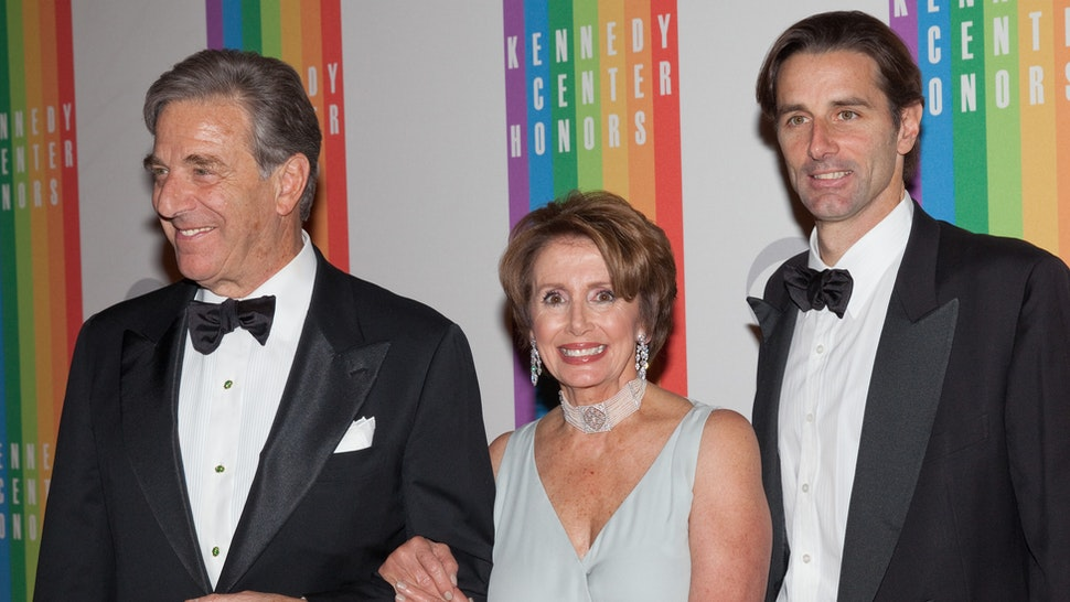 House Minority Leader Nancy Pelosi (C) arrives with her husband Paul Pelosi (L) and son Paul Pelosi, Jr. at the 35th Kennedy Center Honors, at the Kennedy Center in Washington, DC, December 2, 2012.