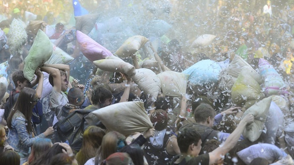 MOSCOW, RUSSIA - SEPTEMBER 27: Hundreds of people organized via social media attend a pillow fight at the Park Fili in Moscow, Russia on September 27, 2015.