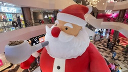 "SHANGHAI, CHINA - DECEMBER 10, 2019 - A 9-meter-high ""Santa Claus"" is set up in the mall, Shanghai, China, December 10, 2019.- PHOTOGRAPH BY Costfoto / Barcroft Media"