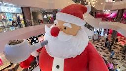 "SHANGHAI, CHINA - DECEMBER 10, 2019 - A 9-meter-high ""Santa Claus"" is set up in the mall, Shanghai, China, December 10, 2019.- PHOTOGRAPH BY Costfoto / Barcroft Media"