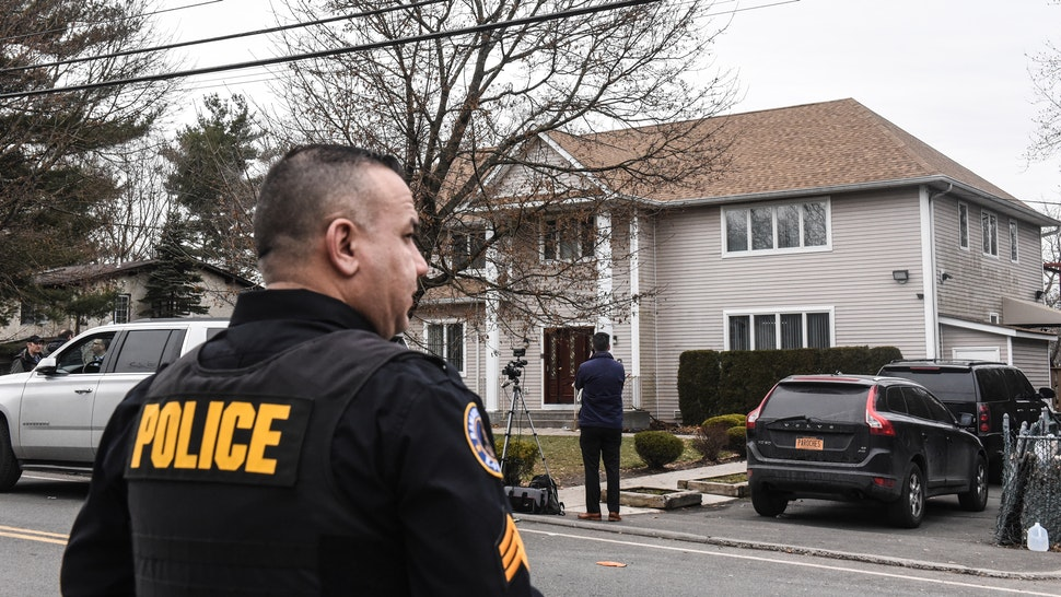 MONSEY, NY - DECEMBER 29: A member of the Ramapo police stands guard in front of the house of Rabbi Chaim Rottenberg on December 29, 2019 in Monsey, New York. Five people were injured in a knife attack during a Hanukkah party and a suspect, identified as Grafton E. Thomas, as was later arrested in Harlem.