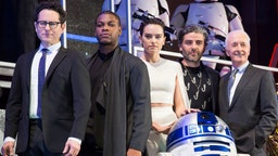 J.J. Abrams, John Boyega, Daisy Ridley, Oscar Isaac and Anthony Daniels witrh Star Wars character R2-D2 attend the special fan event for 'Star Wars: The Rise of Skywalker' at Roppongi Hills on December 11, 2019 in Tokyo, Japan. (Photo by Yuichi Yamazaki/Getty Images)