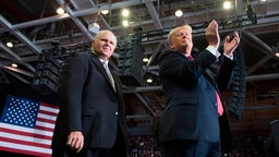 US President Donald Trump alongside radio talk show host Rush Limbaugh arrive at a Make America Great Again rally in Cape Girardeau, Missouri on November 5, 2018. (Photo by Jim WATSON / AFP) (Photo credit should read JIM WATSON/AFP via Getty Images)