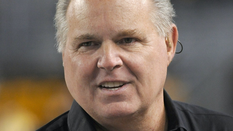 Radio talk show host and political commentator Rush Limbaugh looks on from the sideline before a National Football League game between the New England Patriots and Pittsburgh Steelers at Heinz Field on November 14, 2010 in Pittsburgh, Pennsylvania. The Patriots defeated the Steelers 39-26. (Photo by George Gojkovich/Getty Images)