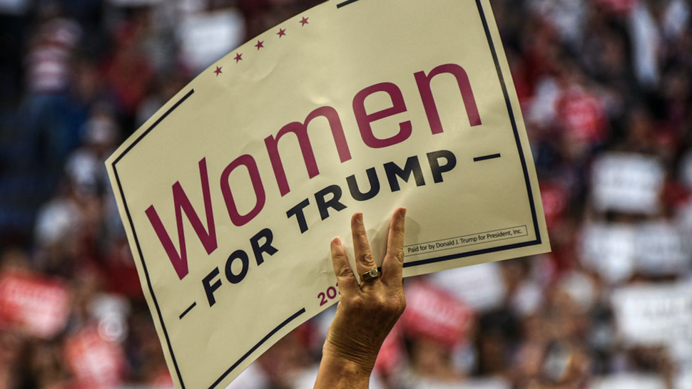 A Trump supporter waves a Women for Trump placard at Rupp Arena during a Donald Trump rally in Lexington.