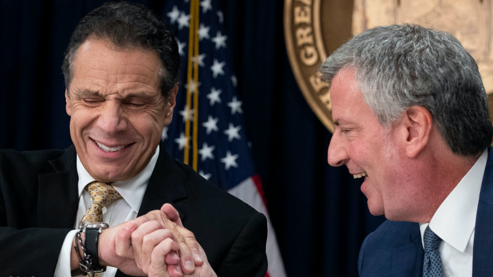 New York Governor Andrew Cuomo and New York City Mayor Bill de Blasio shake hands during a press conference to discuss Amazon's decision to bring a new corporate location to New York City, November 13, 2018 in New York City.