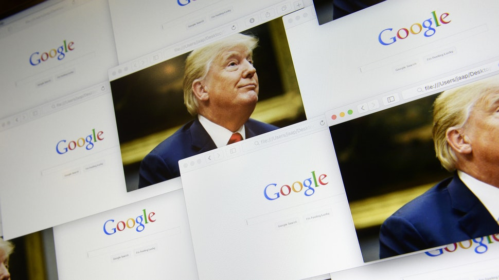 Google logos are seen in this photo illustration together with images of Donald Trump on September 5, 2018.