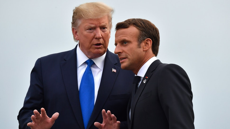 French President Emmanuel Macron (R) chats with US President Donald Trump at the Biarritz lighthouse, southwestern France, ahead of a working dinner on August 24, 2019, on the first day of the annual G7 Summit attended by the leaders of the world's seven richest democracies, Britain, Canada, France, Germany, Italy, Japan and the United States. - EU leaders rounded on US President Donald Trump over his trade threats at a G7 summit in France overshadowed by trans-Atlantic tensions and worries about the global economy.