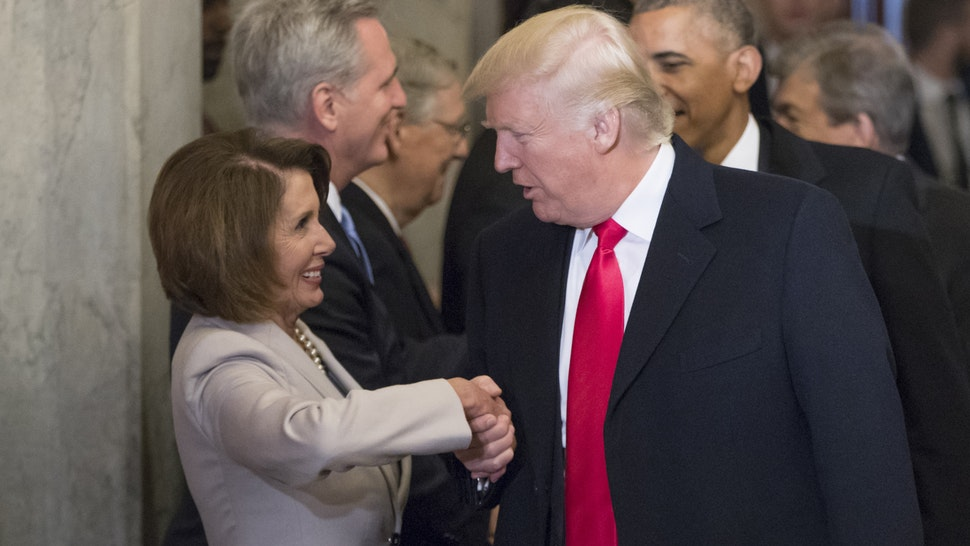 WASHINGTON, DC - JANUARY 20: President-elect Donald Trump (C) and President Barack Obama (R) are greeted by members of the Congressional leadership including House Minority Leader Nancy Pelosi (D-CA) as they arrive for Trump's inauguration ceremony at the Capitol on January 20, 2017 in Washington, DC. Trump became the 45th president of the United States.