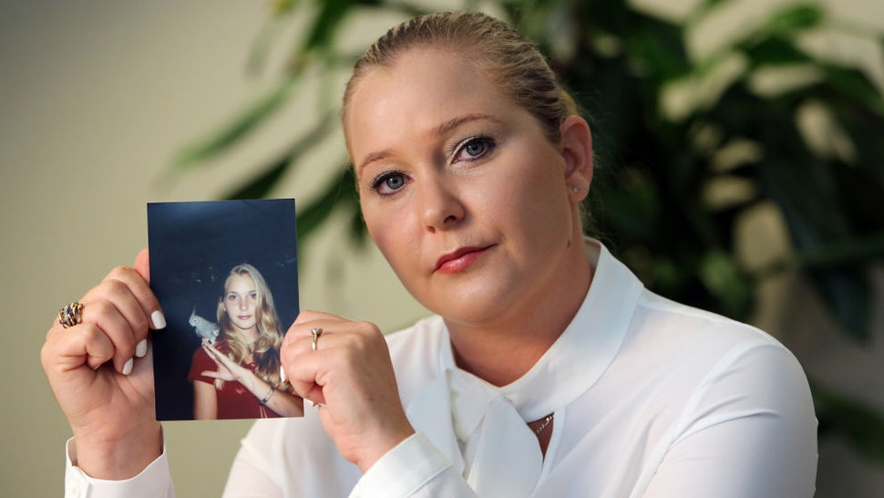 Virginia Roberts holds a photo of herself at age 16, when she says Palm Beach multimillionaire Jeffrey Epstein began abusing her sexually. (Emily Michot/Miami Herald/TNS)
