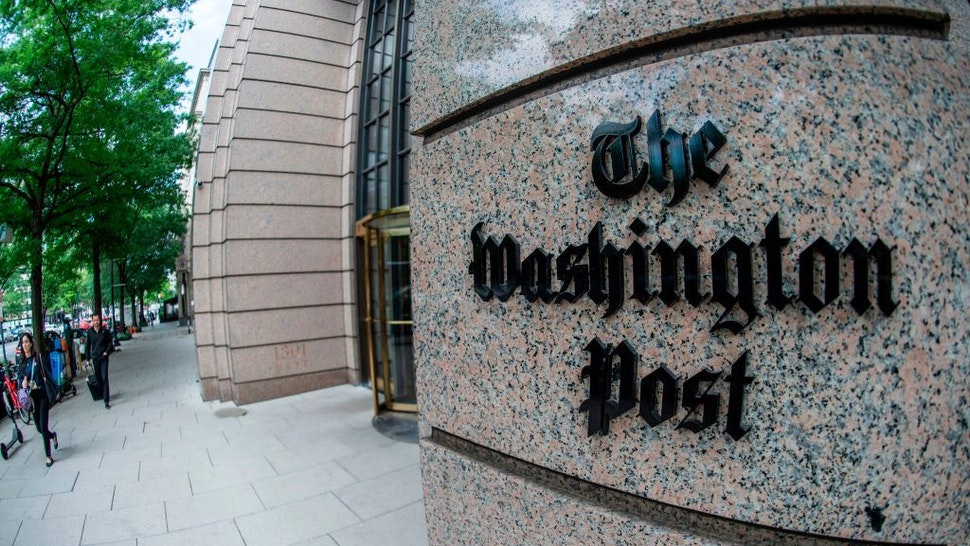 The building of the Washington Post newspaper headquarter is seen on K Street in Washington DC on May 16, 2019. - The Washington Post is a major American daily newspaper published in Washington, D.C., with a particular emphasis on national politics and the federal government. It has the largest circulation in the Washington metropolitan area. (Photo by Eric BARADAT / AFP) (Photo credit should read ERIC BARADAT/AFP via Getty Images)