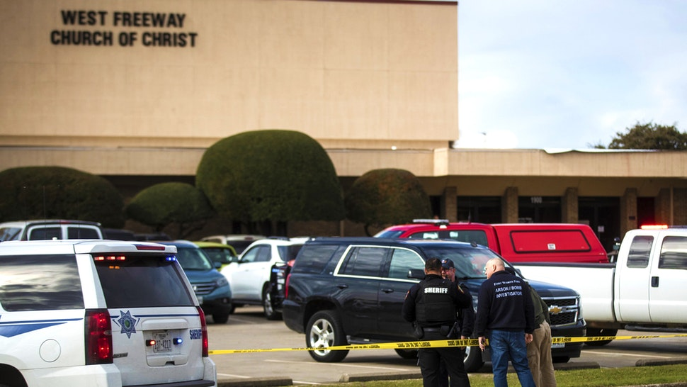 Police and fire department officials surround a scene of a shooting Sunday, Dec. 29, 2019, at West Freeway Church of Christ in White Settlement, Texas.