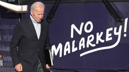 """Democratic presidential candidate, former Vice President Joe Biden arrives at a campaign stop on December 2, 2019 in Emmetsburg, Iowa. The stop was part of his 650-mile """"No Malarkey"""" campaign bus trip through rural Iowa. The 2020 Iowa Democratic caucuses will take place on February 3, 2020, making it the first nominating contest for the Democratic Party in choosing their presidential candidate to face Donald Trump in the 2020 election."""