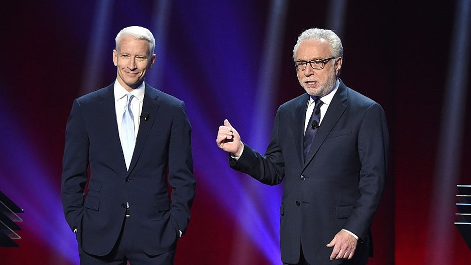 Anderson Cooper and Wolf Blitzer appear on stage during Turner Upfront 2016 show at The Theater at Madison Square Garden on May 18, 2016 in New York City.