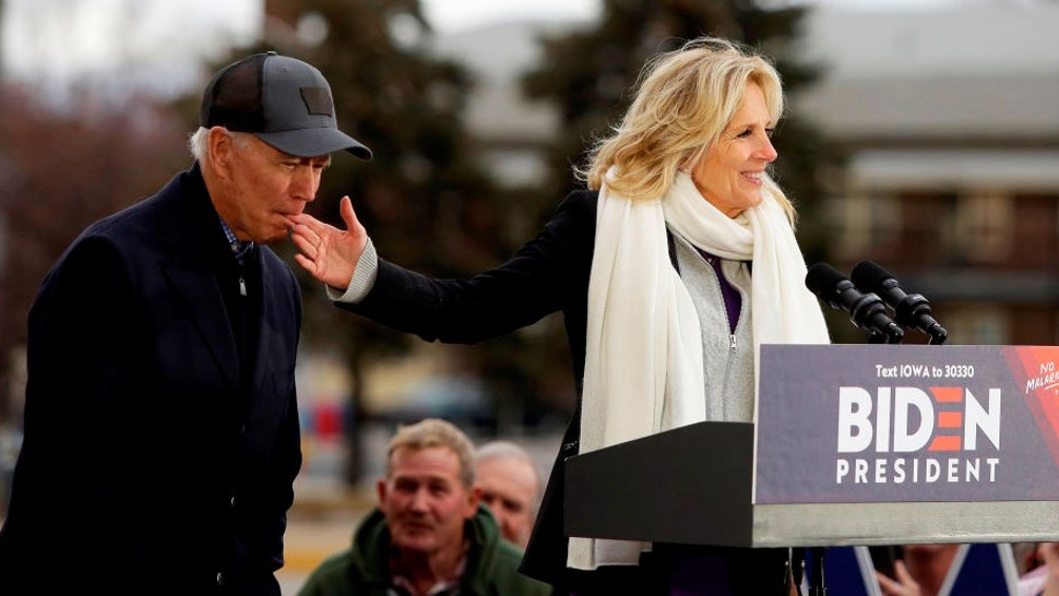 Democratic presidential candidate, former Vice President Joe Biden bites the finger of his wife Jill Biden as she introduces him during a campaign event on November 30, 2019 in Council Bluffs, Iowa. Biden, who begins his eight-day bus tour across Iowa on Saturday, once lead the state in the polls but now trails presidential candidates Pete Buttigieg and Elizabeth Warren with just under 3 months until the 2020 Iowa Democratic caucuses.
